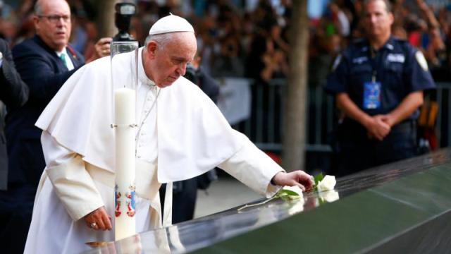 Pope Francis places a rose at the South Pool of the National 9/11 Memorial and Museum Sept. 25 in New York. (CNS photo/Tony Gentile)