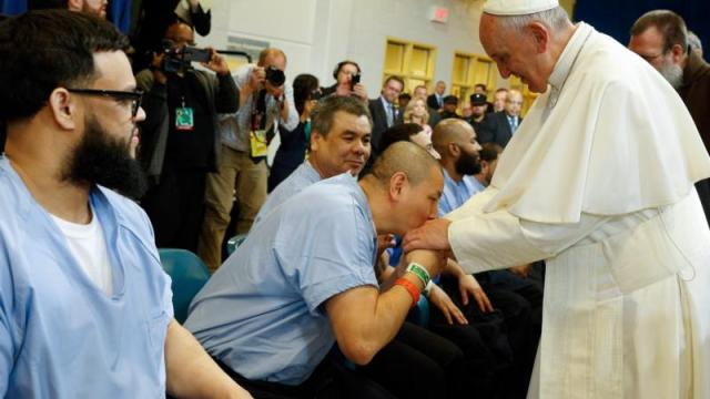 A prisoner kisses the hand of Pope Francis as he visits the Curran-Fromhold Correctional Facility in Philadelphia Sept. 27. (CNS photo/Paul Haring)