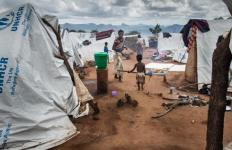 Refugees walk outside their tents in early February in the Kapise refugee camp in Mwanza, Malawi. Catholic officials who work with refugees in Malawi said they have warned albinos against going to certain areas of such camps because crimes against albinos are on the rise. (CNS photo/Erico Waga, EPA)