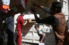 Volunteers unload aid supplies in late May near Damascus, Syria. A group of bishops, religious and church personnel working in Syria met to discuss better ways to confront the immense humanitarian crisis unfolding in their country. (CNS photo/Mohammed Badra, EPA) See SYRIA-CHURCH-CHARITY June 30, 2016.