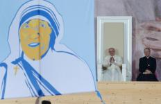 Pope Francis applauds as a banner showing Blessed Mother Teresa is presented during the World Youth Day welcoming ceremony in Blonia Park in Krakow, Poland, July 28. (CNS photo/Paul Haring) See POPE-POLAND-WYD-WELCOME July 28, 2016.