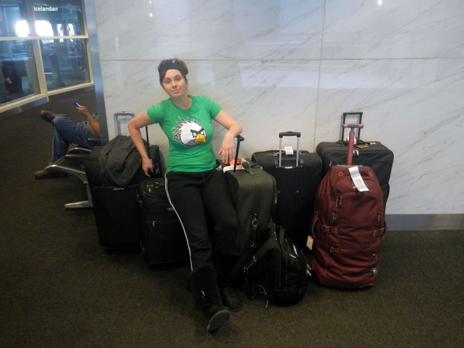 Sitting on top of my family's luggage in an airport