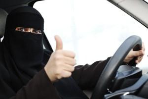 An Arab woman driving a car