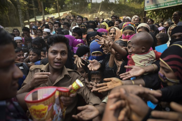 Rohingya refugees from Myanmar waiting for food aid in Kutupalong refugee camp near Cox's Bazar, Bangladesh, March 2017