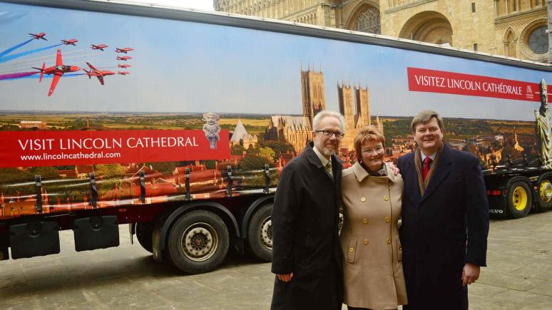 Phil Hamlyn Williams, CEO at Lincoln Cathedral, Carol Heidschuster, Works Manager at the Cathedral, and Peter Denby of Denby Transport, with the Lincoln Lorry. Photo: Steve Smailes for The Lincolnite