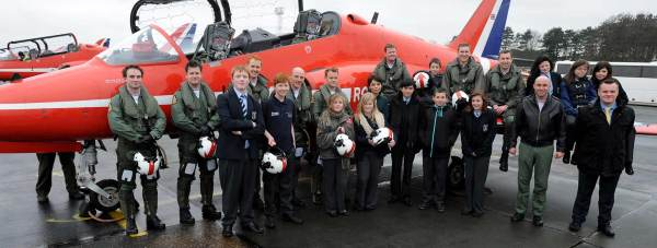 Red Arrows pilots at RAF Cranwell with Blue Skies students from The Priory Witham Academy, Assistant Head John Wiles and Dr Emma Egging of the Jon Egging Trust.