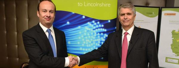 Lincolnshire County Councillor Kelly Smith seals the deal with Bill Murphy, Managing Director of Next Generation Access at BT, at the Onlincolnshire Digital conference in Lincoln. Photo: Steve Smailes for The Lincolnite