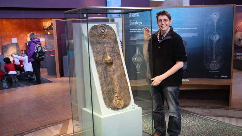 The Collection Access Officer, Antony Lee, with the Witham Shield.