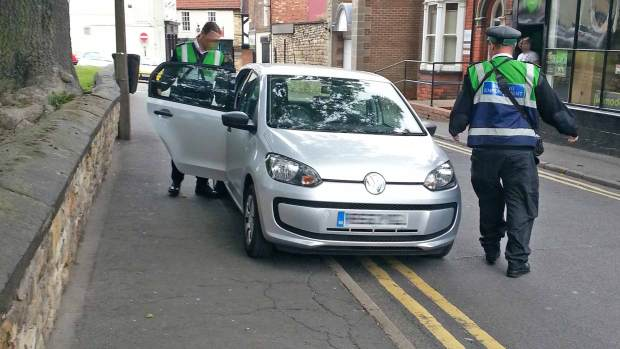 Traffic wardens captured parking on double yellow lines on St Martin's Lane in Lincoln to ticket motorists. The council said they are allowed to do so on the job. Photo: Andy Ferguson