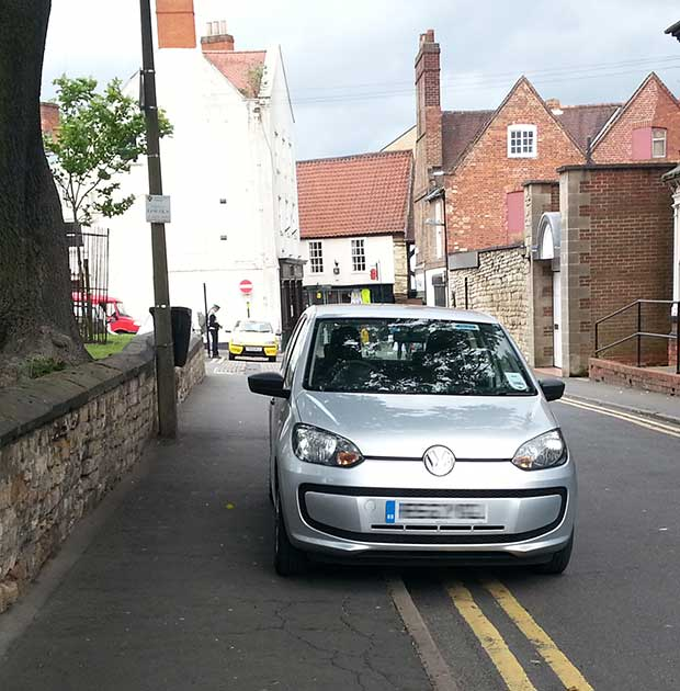 The parking wardens got out of their car for around 10 minutes to ticket two other vehicles parked illegally. Photo: Andy Ferguson