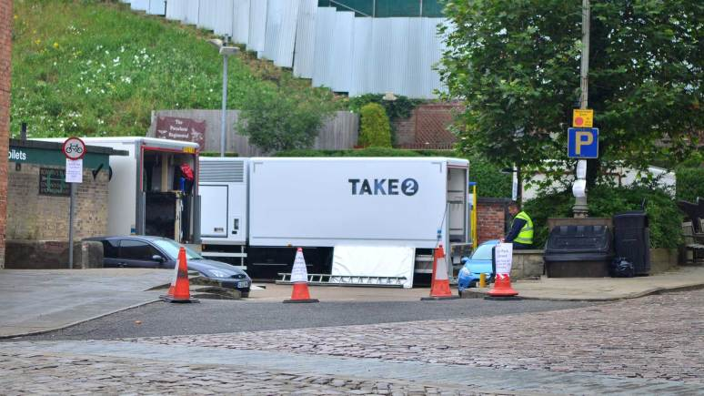 Filming trucks and gear are stationed outside the entrance to the castle. Photo: Steve Smailes for The Lincolnite