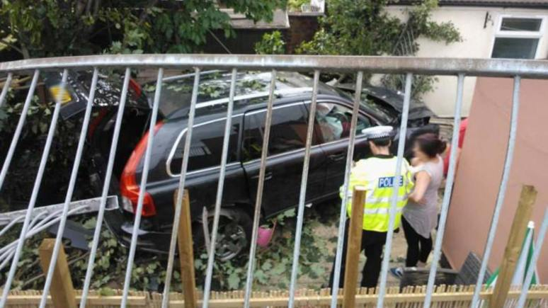 The car crashed through two sets of traffic lights and then dropped into a back garden.
