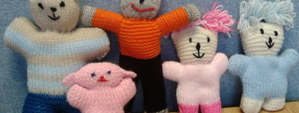 A typical knitted bear given to children at the scene of a road traffic accident.