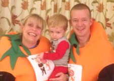 Caroline Hughes with Luke and her partner, Steve Riley. The pair dressed as carrots to raise money for a Nystagmus charity.