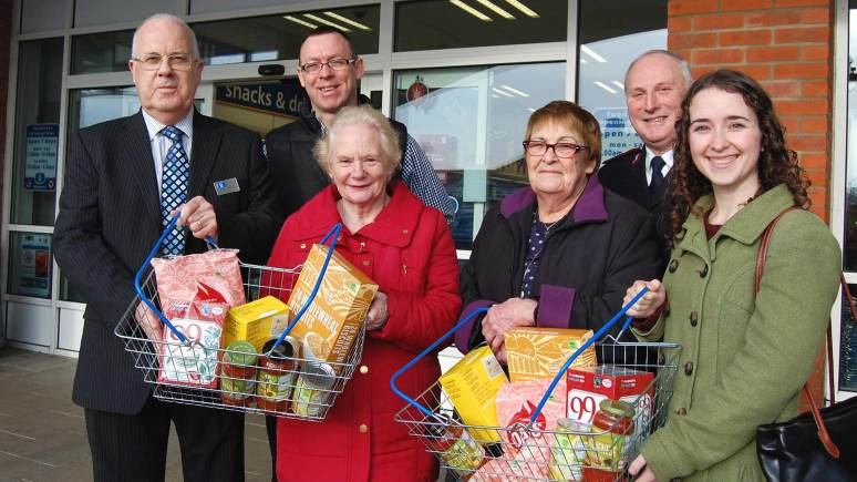(L-R) President of Lincolnshire Co-op Malcolm Hoskins, Rod Munro from Sleaford Foodbank, Joan Townsend and Rose Chave from St Luke's Church Foodbank in Birchwood, Geoff Martin from Gainsborough Salvation Army Foodbank and Bethan Lloyd from Lincoln Foodbank. Photo: Lincolnshire Co-op