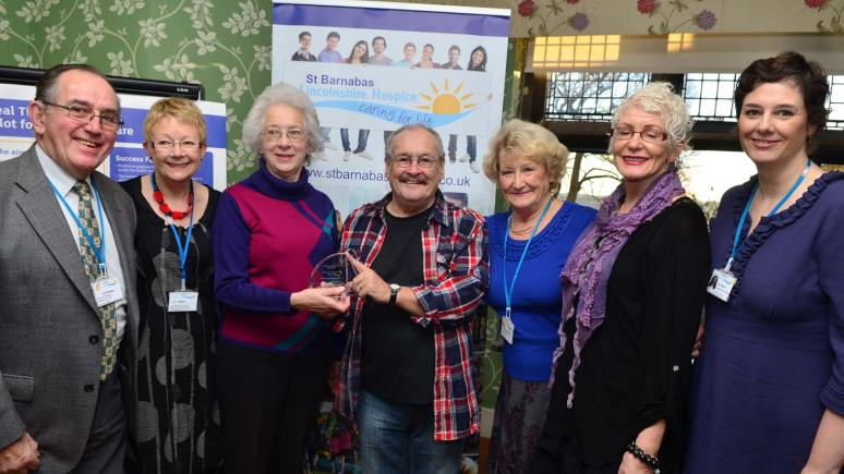 Bobby Ball presents the St Barnabas Lincolnshire Hospice team with the Innovation in Volunteering Award. Photo: Steve Smailes for The Lincolnite