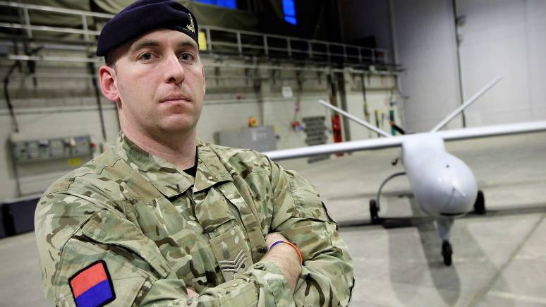 RAF Waddington Sargeant Alexander Buchanan MBE with a Reaper Drone in the background. Photo: SAC Blake Carruthers