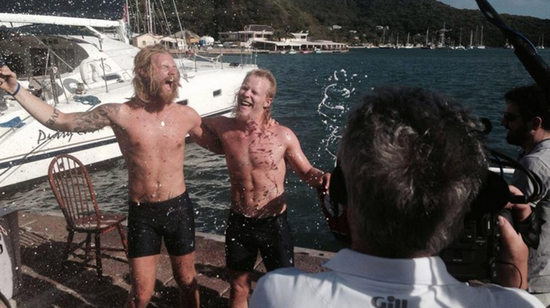 Jamie Sparks (L) and Luke Birch (R) celebrating their arrival on dry land in Antigua. Photo: @2boysinaboat