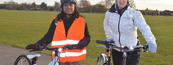 Dr Jean Rebello (L) learns how to ride a bike with Access LN6 Adult Cycle Training instructor Pauline Yemm. Photo: LCC