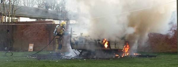 Firefighters extinguished a caravan on fire on Browning Drive in Lincoln on March 17, 2014. Photo: Nigel Mulhall