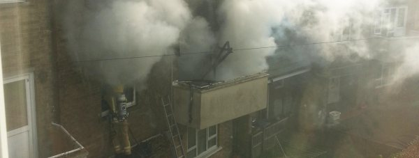 Firefighters tackling the fire on Asterby Close in Lincoln. Photo: Tracy Wilson