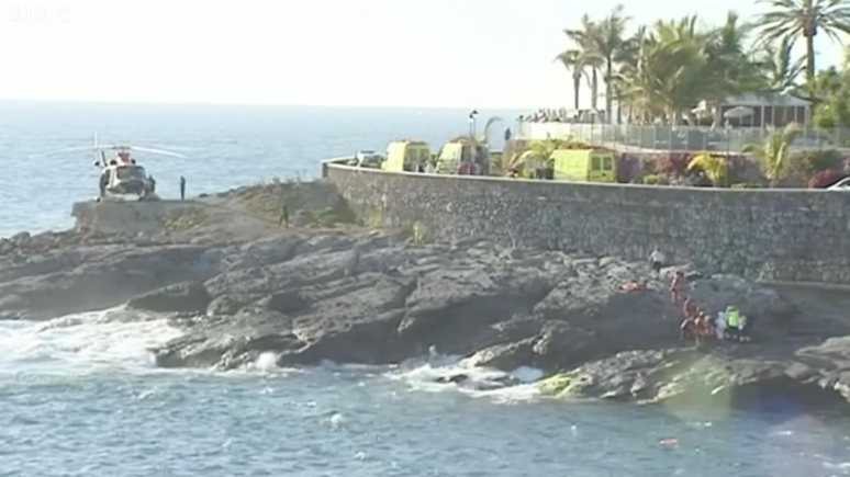 Rescue teams at the scene of the incident at Playa Paraiso, in the south-west of the Tenerife island. Credit: BBC screen capture