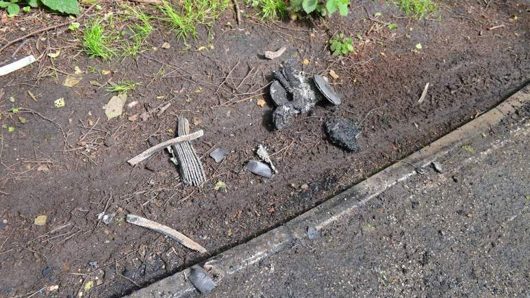 Debris after the car set on fire at the entrance to Hartsholme Park.