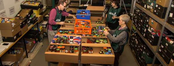 Volunteers sorting food donation at a Trussell Trust foodbank