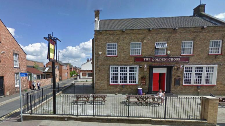 The man and woman were sees fighting on Queen Street near to The Golden Cross pub in Lincoln. Photo: Google Street View