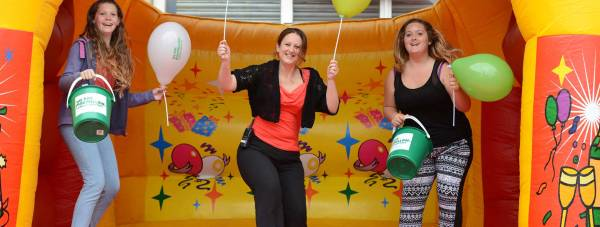 St Marks facilities manager Nikki North (centre) joins in the fun with shoppers Libby Hart-Rose (left) and Molly Smith