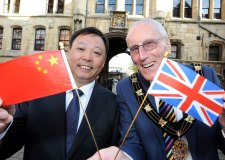 Mayor of Lincoln Brent Charlesworth celebrates signing the twinning agreement with the Mayor of Nanchang, Guo An.