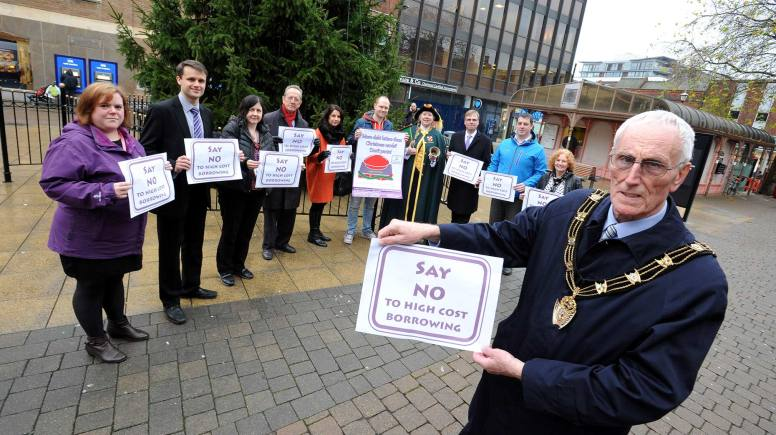 Partners from Lincoln Against Poverty's 'Say no to high cost borrowing' campaign are joined in the city centre by Mayor of Lincoln, Councillor Brent Charlesworth. Photo: Stuart Wilde