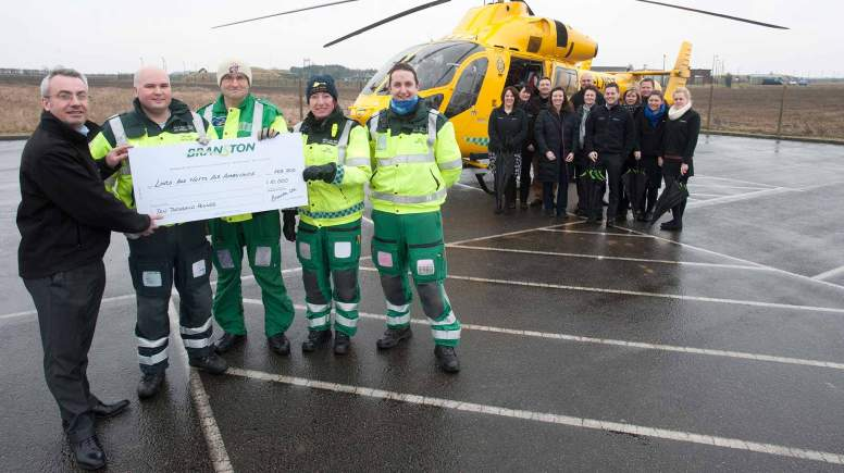 Branston staff presenting a cheque to the Lincolnshire and Nottinghamshire Air Ambulance