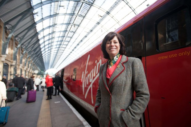Rail Minister Claire Perry with the first train to carry the new Virgin Trains East Coast livery at London King's Cross station.