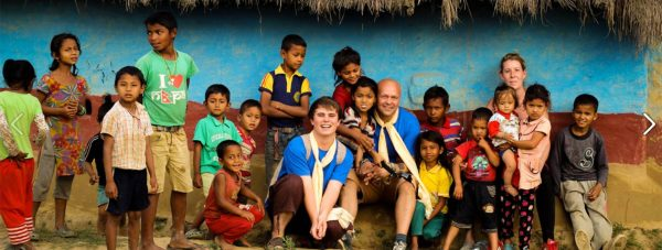 Garry and Leo with just some of the thousands of children the scheme has helped so far in Nepal.