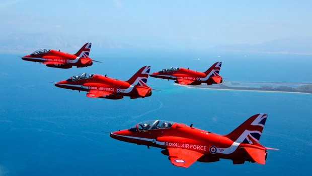 The 2015 Royal Air Force Aerobatic Team, the Red Arrows, perform the Big Battle arrival loop. MoD/Crown Copyright 2015