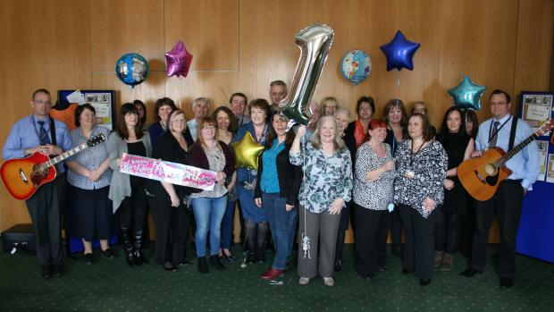 The team celebrate the Wellbeing Service's first birthday