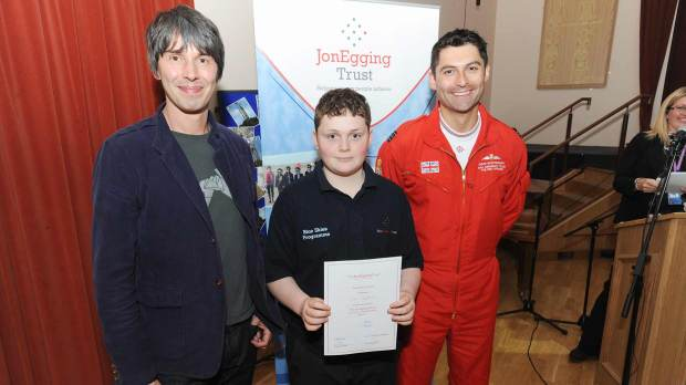 Brian Cox and Sqdn Leader David Montenegro (Red 1) presenting a graduation certificate to a Blue Skies student. Photo: Stuart Wilde
