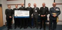 The force presented a fundraising cheque to Bowel Cancer UK. Photo: Steve Smailes for The Lincolnite