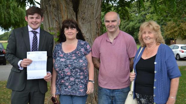 Alexander Maughan celebrating his results with his family