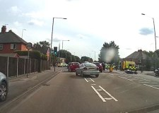 A biker has died in a crash with a car in Lincoln.