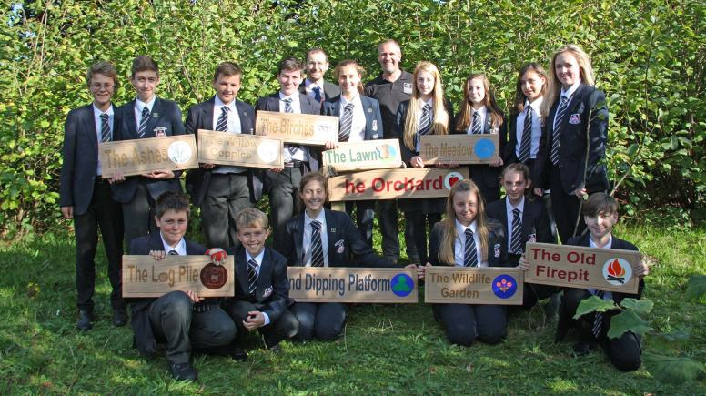 The students designed the new signs for the different sections of the park.