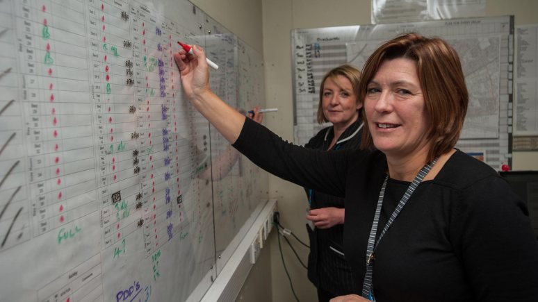 Abigail Norris (left) and Jackie Ryan (right) organising the bed flow at Lincoln County Hospital and the spaces available for patients. Photo: Steve Smailes for The Lincolnite