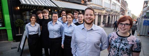 Staff outside the new Lincoln Côte Brasserie. Photo: Steve Smailes for The Lincolnite