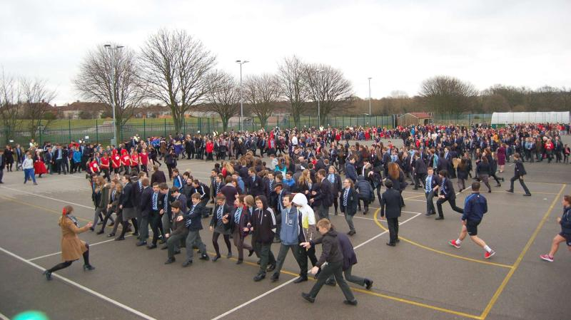Almost 900 school children and staff smashed the world record goal.