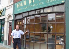 Gino Scumaci, owner of Hair by Gino has served 50 years in his store on Monks Road. Photo: The Lincolnite