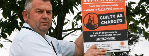 Councillor Richard Wright with one of North Kesteven District Council's fly-tipping signs