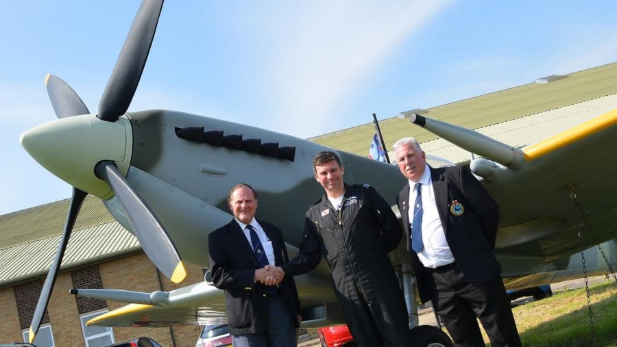 LLA Chairman Ray Bainborough with Officer Commanding  BBMF Squadron Andy Millikin and LLA Vice Chair John Ball, with the model Spitfire