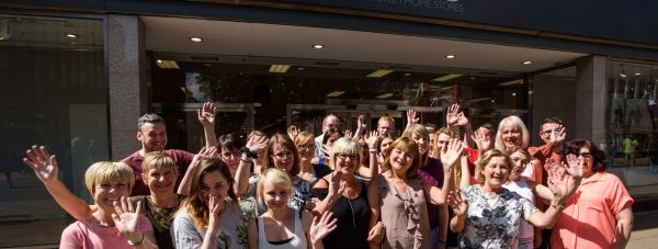 Staff at BHS on Lincoln High Street wave goodbye to their customers in a final farewell. Photo: Steve Smailes for The Lincolnite