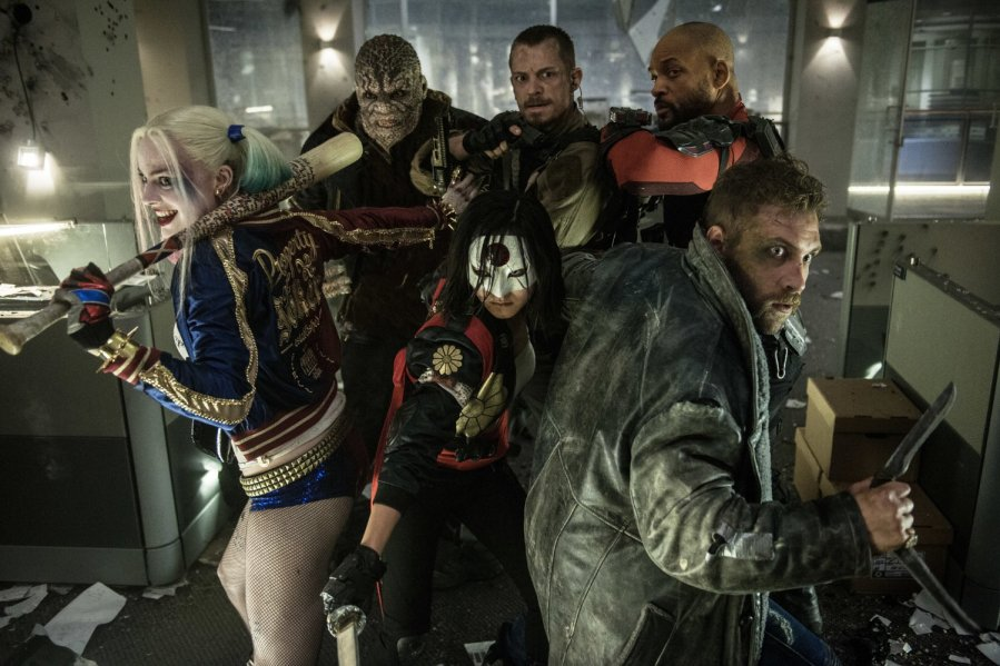 Will Smith, Adewale Akinnuoye-Agbaje, Joel Kinnaman, Jai Courtney, Margot Robbie, and Karen Fukuhara in Suicide Squad. Photo by Warner Bros.
